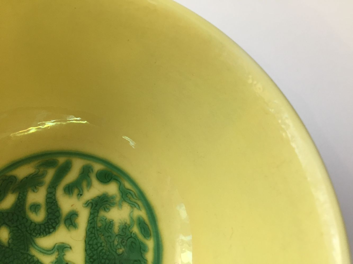 A Chinese porcelain yellow-ground green-enamelled 'dragon medallion' bowl, Kangxi mark and of the - Image 18 of 21