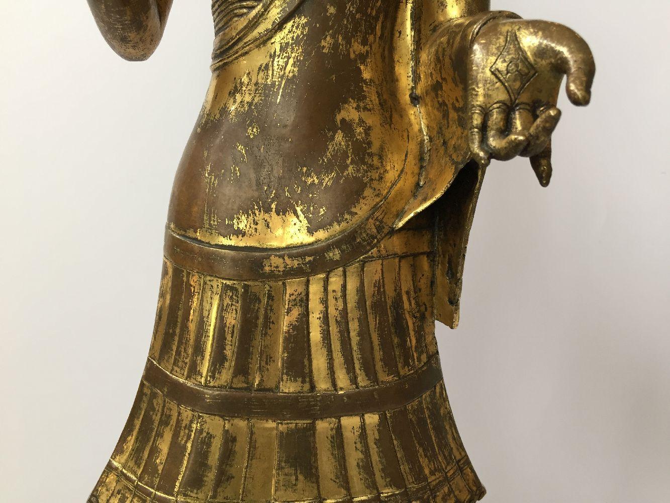 A large Sino-Tibetan gilt bronze standing figure of Avalokiteshvara, 17th century, the right hand is - Image 12 of 16