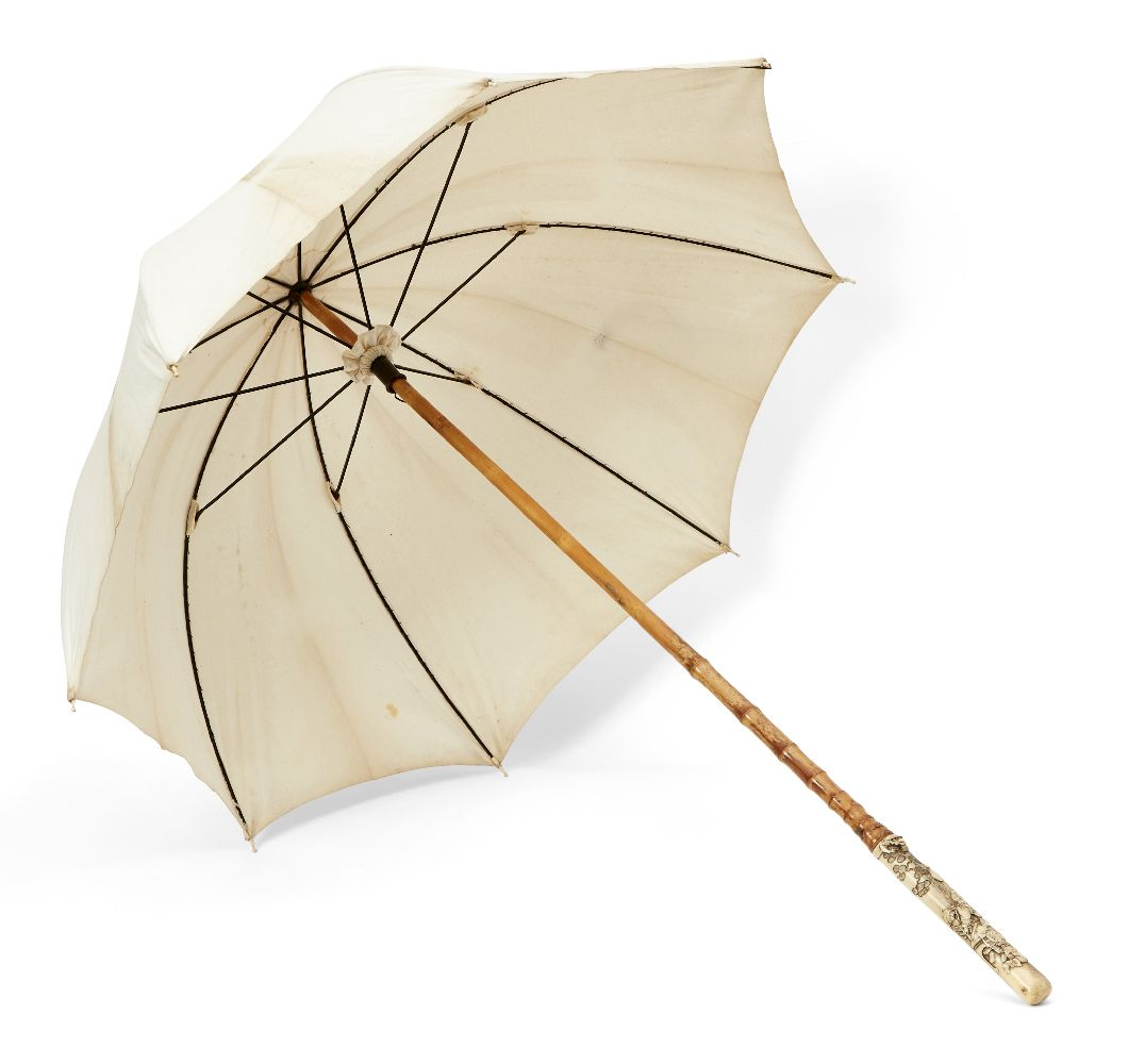 A Japanese parasol with antler handle, 19th century, handle carved intricately depicting shishi head