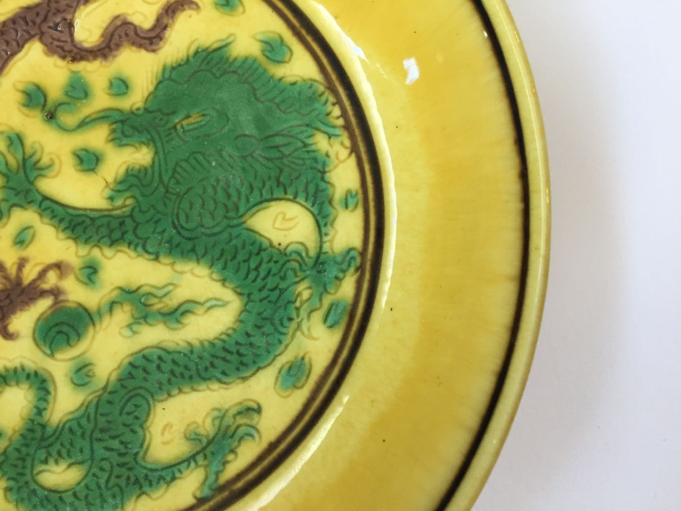 A Chinese yellow-ground aubergine and green-decorated saucer dish, Kangxi mark and of the period, - Image 7 of 13