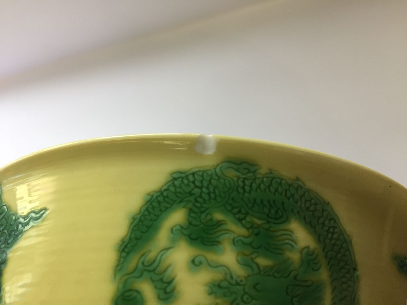 A Chinese porcelain yellow-ground green-enamelled 'dragon medallion' bowl, Kangxi mark and of the - Image 10 of 21