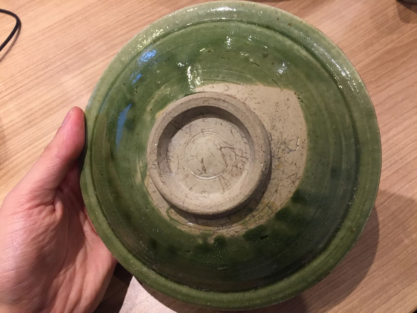 A Vietnamese stoneware green-glazed dish, 14th century, with pinched petal design to the interior - Image 12 of 13