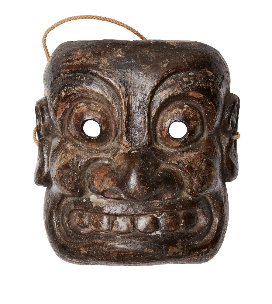 A Japanese mingei wood mask, Meiji period, carved as an Oni with wide eyes and teeth bared, 20cm