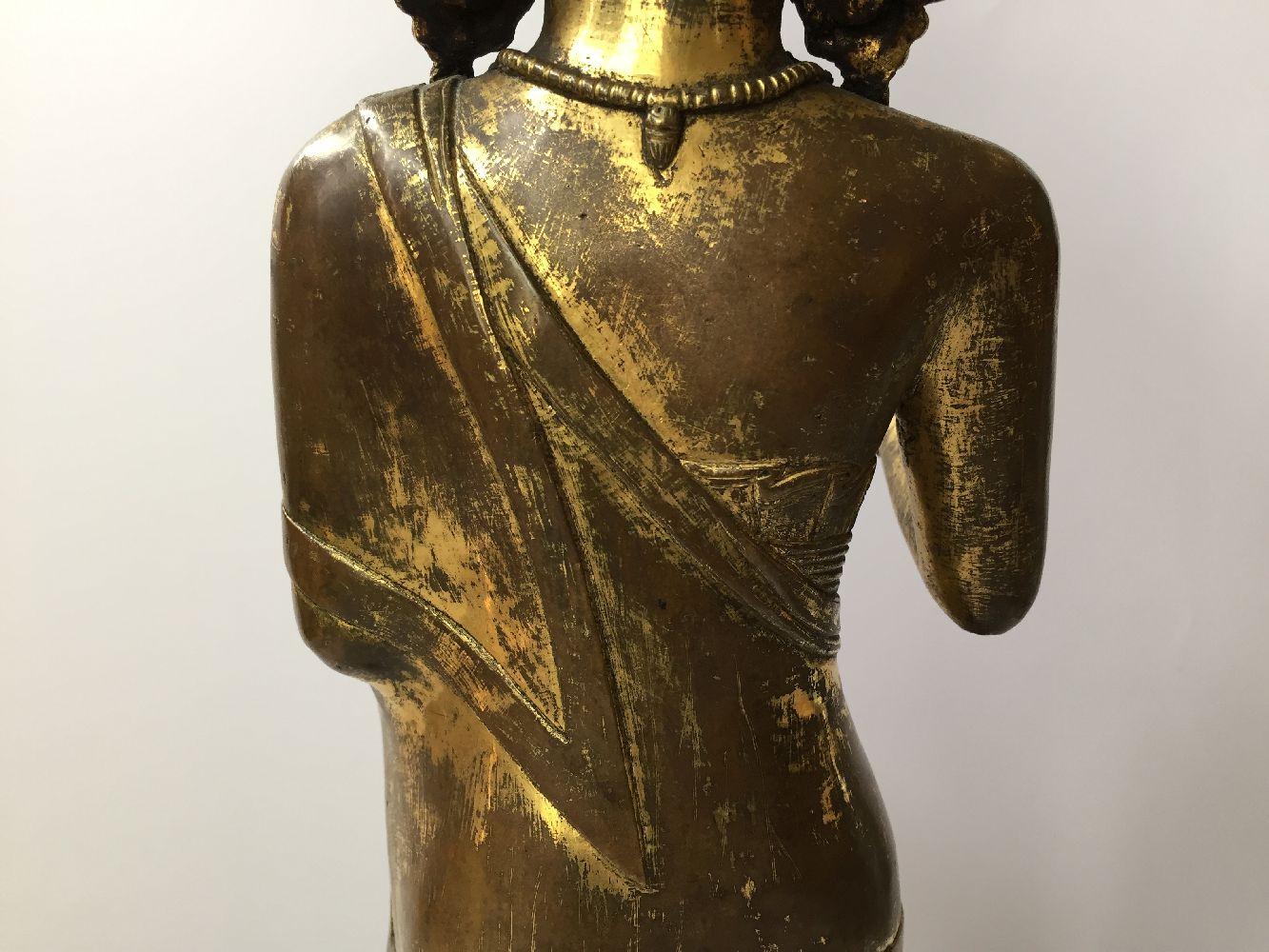 A large Sino-Tibetan gilt bronze standing figure of Avalokiteshvara, 17th century, the right hand is - Image 2 of 16