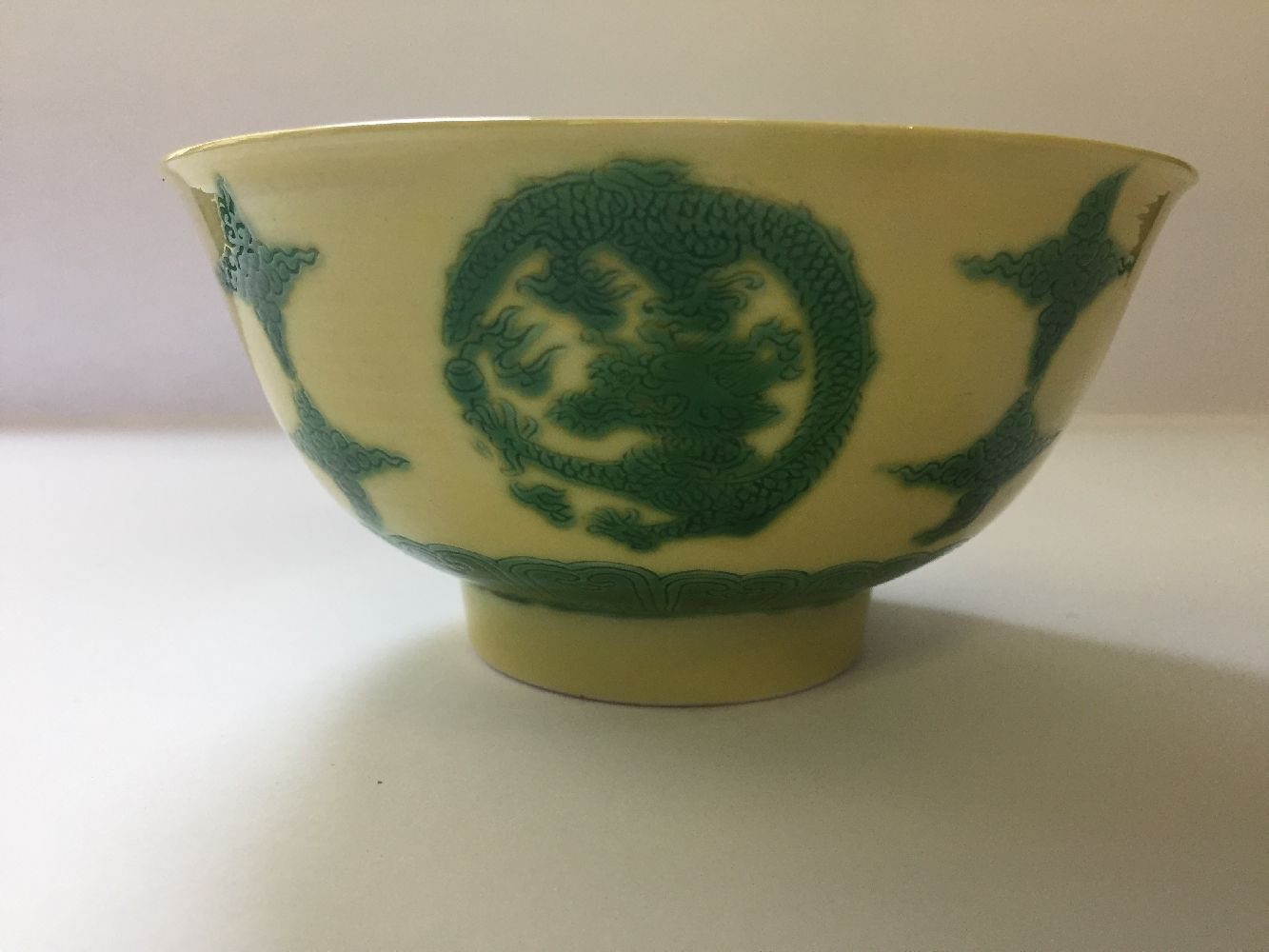 A Chinese porcelain yellow-ground green-enamelled 'dragon medallion' bowl, Kangxi mark and of the - Image 15 of 21