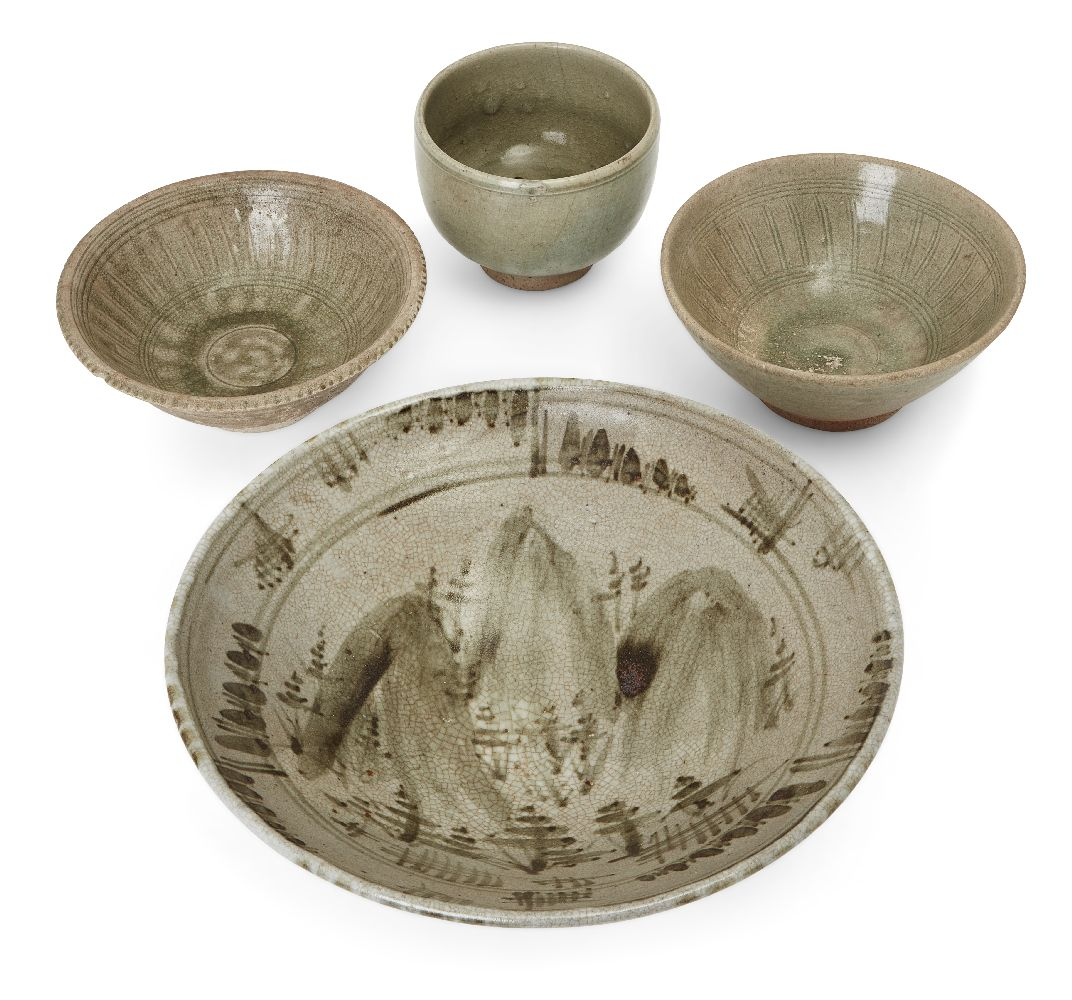 Three Thai Sawankhalok bowls, 15th-16th century, each covered in a celadon glaze, two with fluted