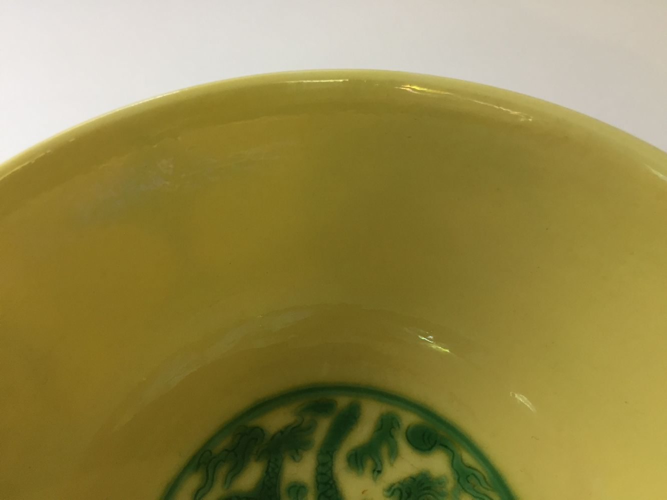 A Chinese porcelain yellow-ground green-enamelled 'dragon medallion' bowl, Kangxi mark and of the - Image 17 of 21