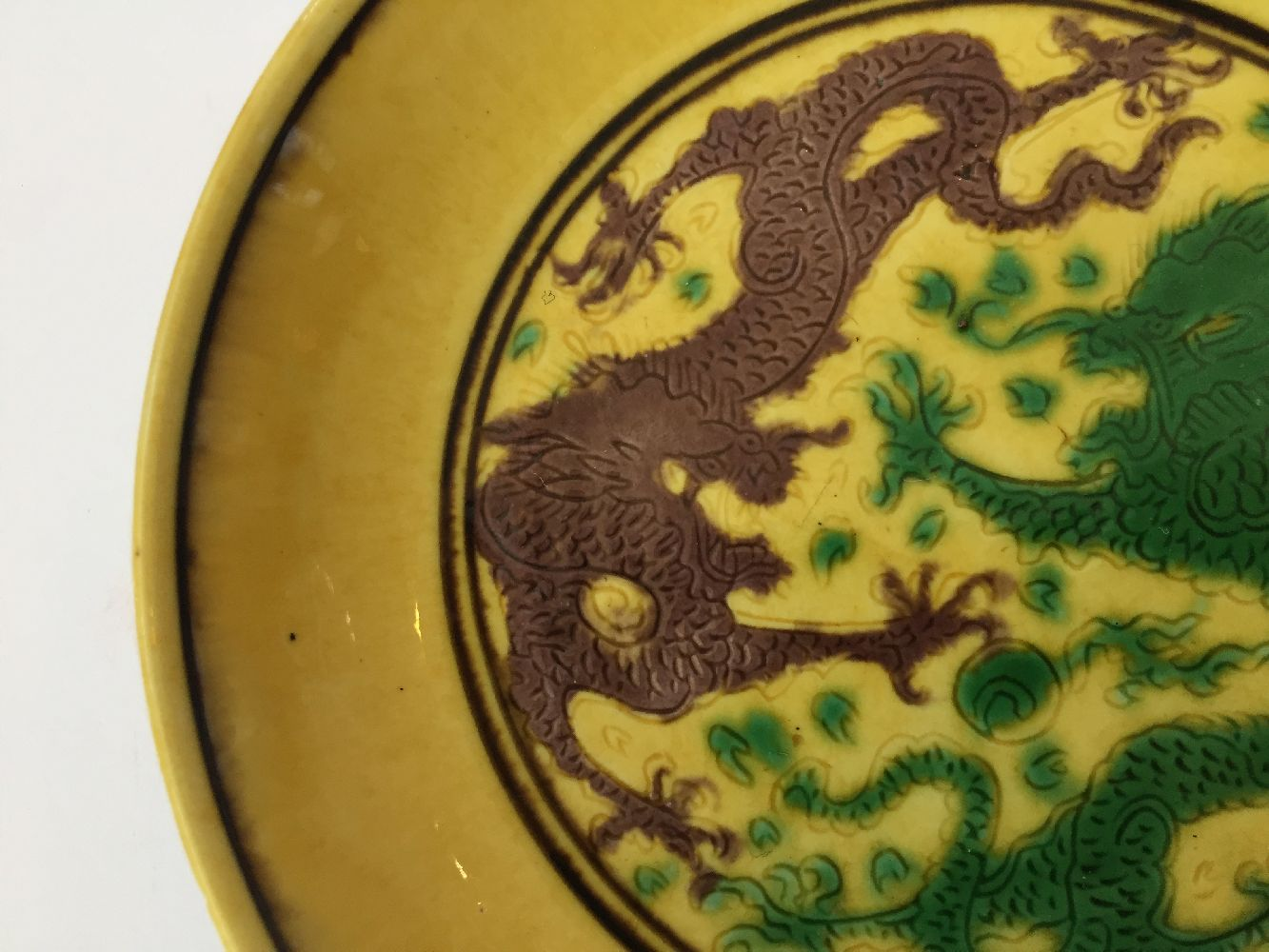 A Chinese yellow-ground aubergine and green-decorated saucer dish, Kangxi mark and of the period, - Image 9 of 13