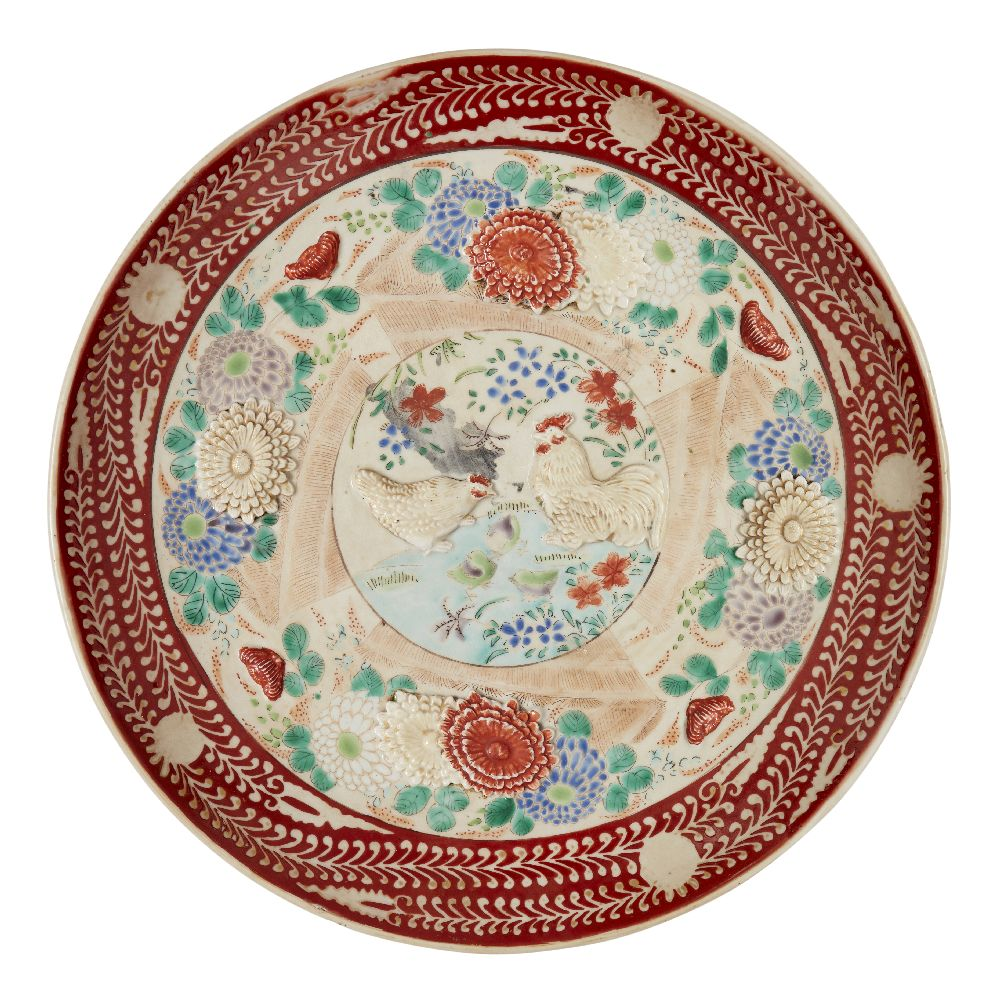 A Japanese porcelain moulded charger, Meiji period, painted in enamels with chrysanthemum sprays and