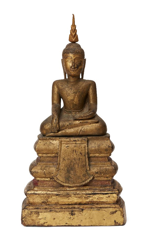A Cambodian gilded wood seated Buddha, 19th century, 31cm high Provenance: Private German collection