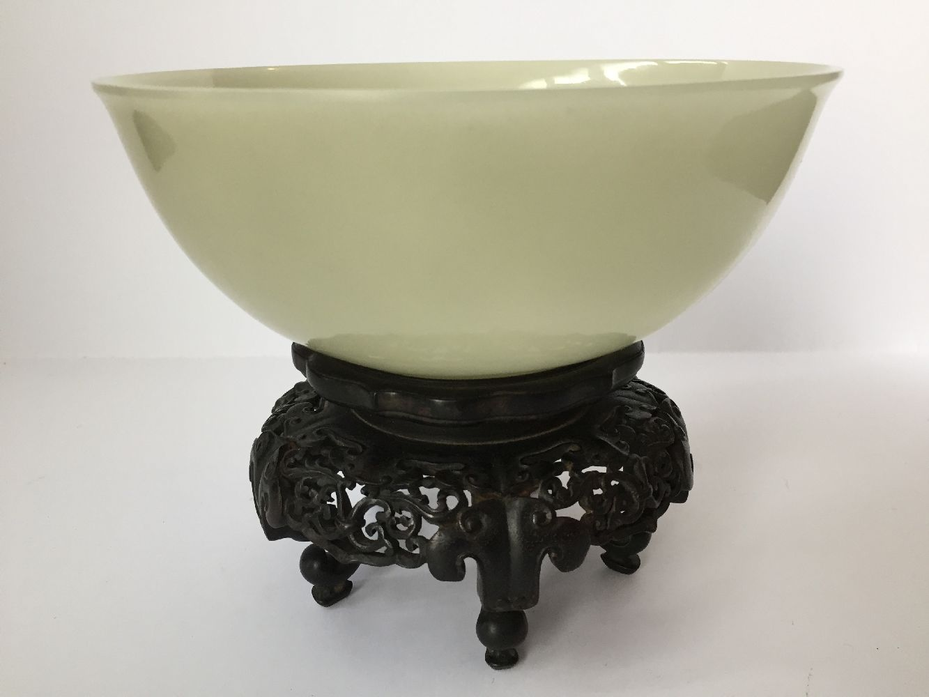 A pair of Chinese pale celadon jade bowls, 19th century, each carved with deep sides and a - Image 7 of 27