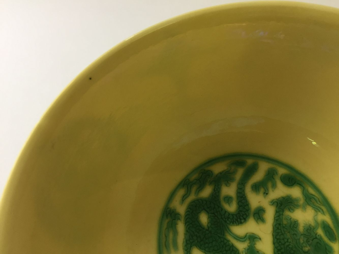 A Chinese porcelain yellow-ground green-enamelled 'dragon medallion' bowl, Kangxi mark and of the - Image 4 of 21