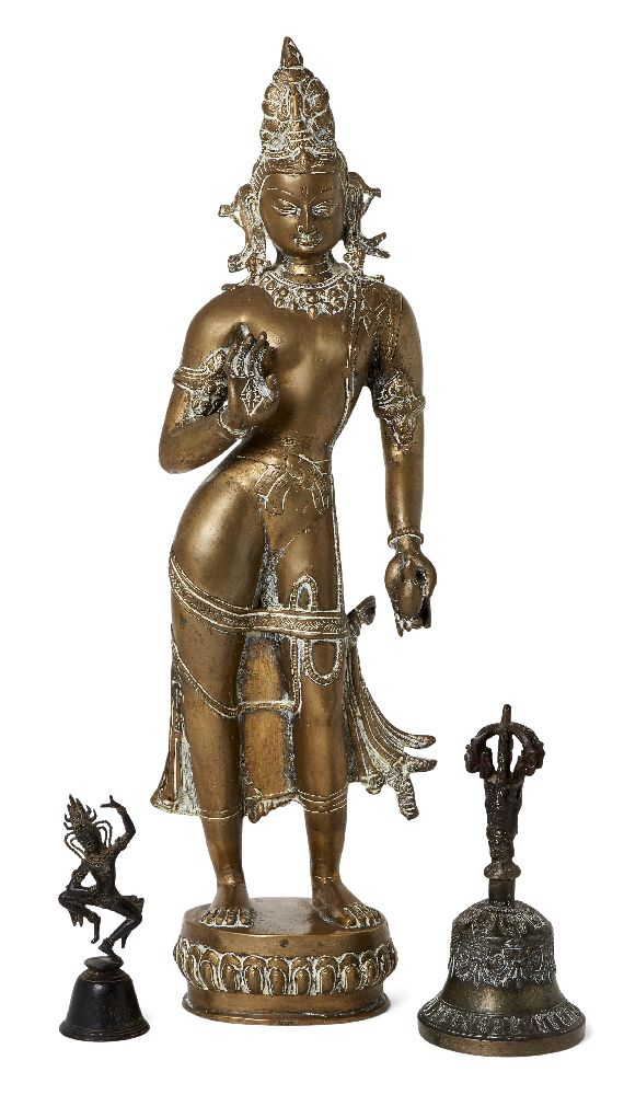 A large Tibetan bronze figure of Parvati, early 20th century, cast standing on a lotus base, 53cm