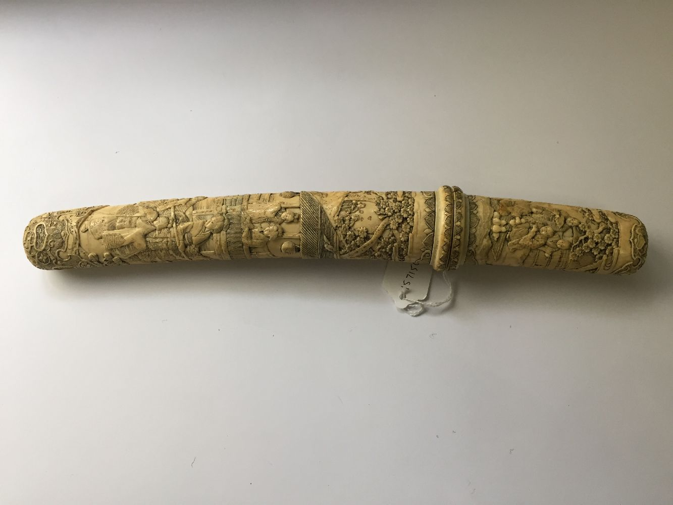 A Japanese carved ivory tanto, Meiji period, in slightly curved form, the scabbard and handle carved - Image 7 of 16