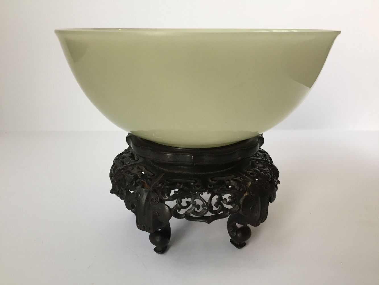 A pair of Chinese pale celadon jade bowls, 19th century, each carved with deep sides and a - Image 20 of 27