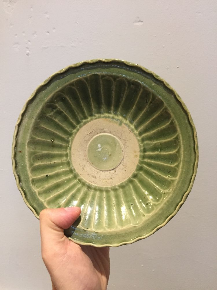 A Vietnamese stoneware green-glazed dish, 14th century, with pinched petal design to the interior - Image 6 of 13