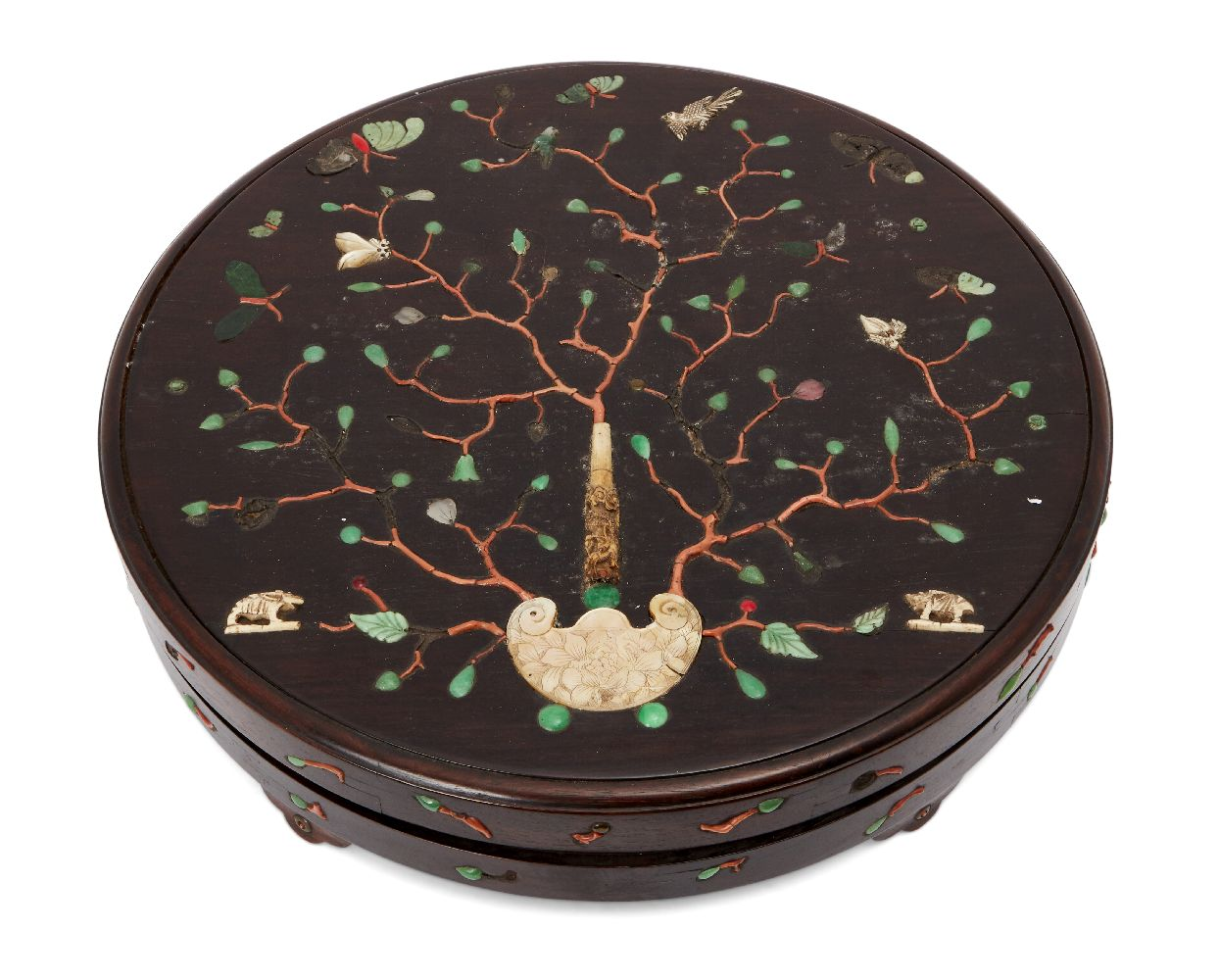A Chinese hardwood circular box and cover, 18th century, inlaid with a carved ivory handle issuing