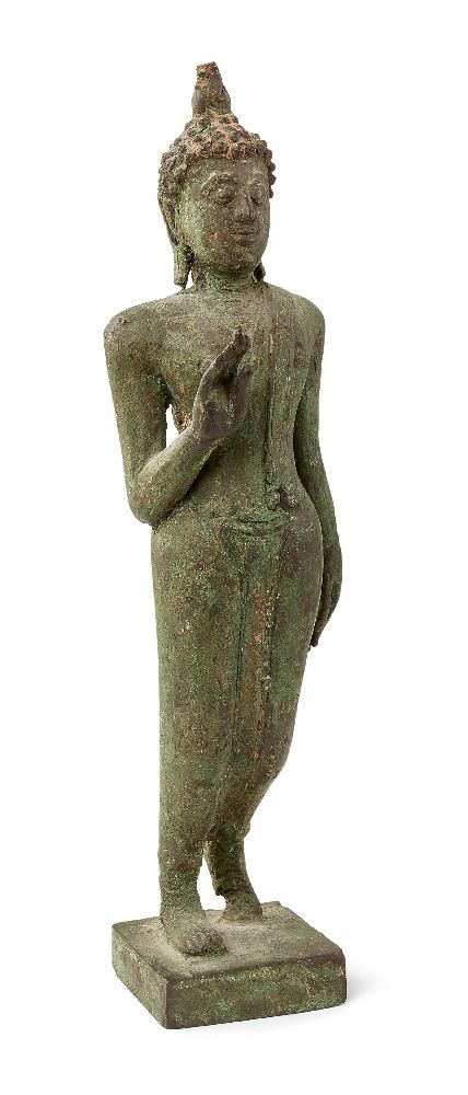 A Thai bronze figure of a walking Buddha, early 19th century, cast striding forward with right