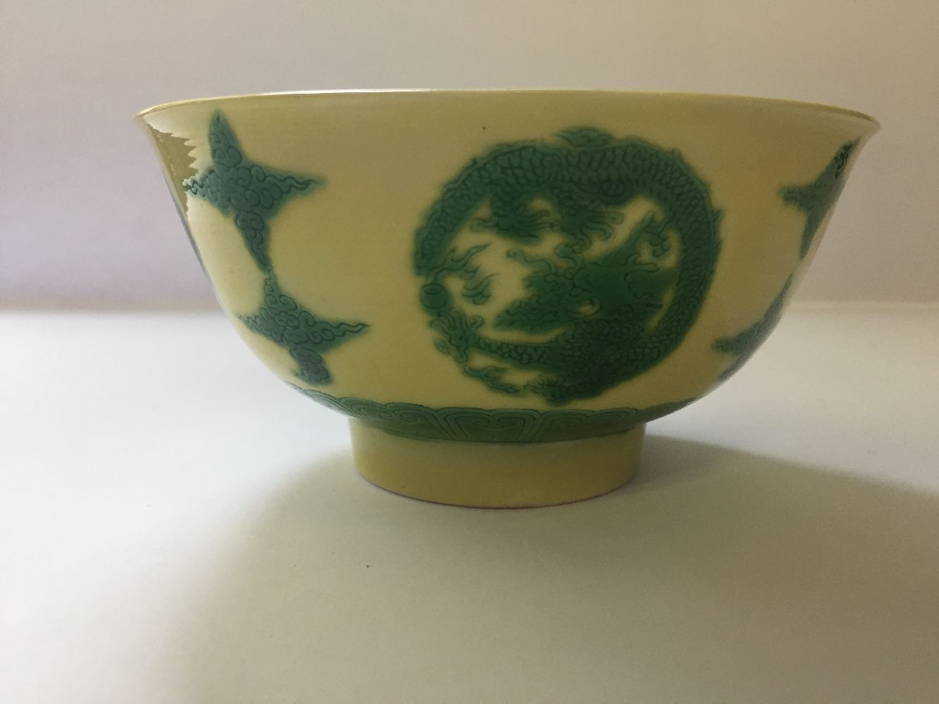 A Chinese porcelain yellow-ground green-enamelled 'dragon medallion' bowl, Kangxi mark and of the - Image 12 of 21