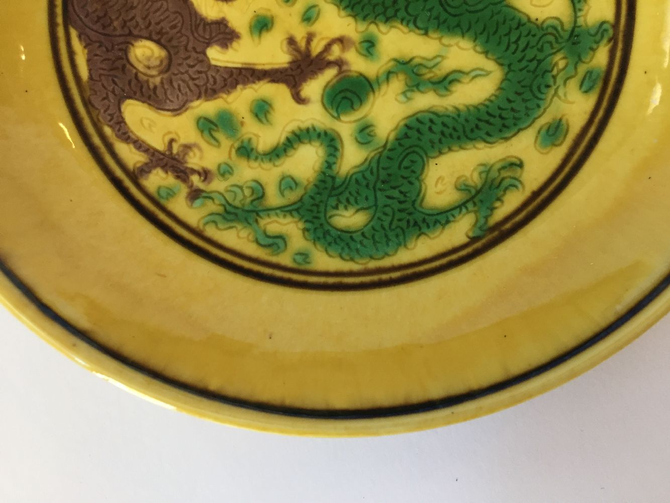 A Chinese yellow-ground aubergine and green-decorated saucer dish, Kangxi mark and of the period, - Image 8 of 13
