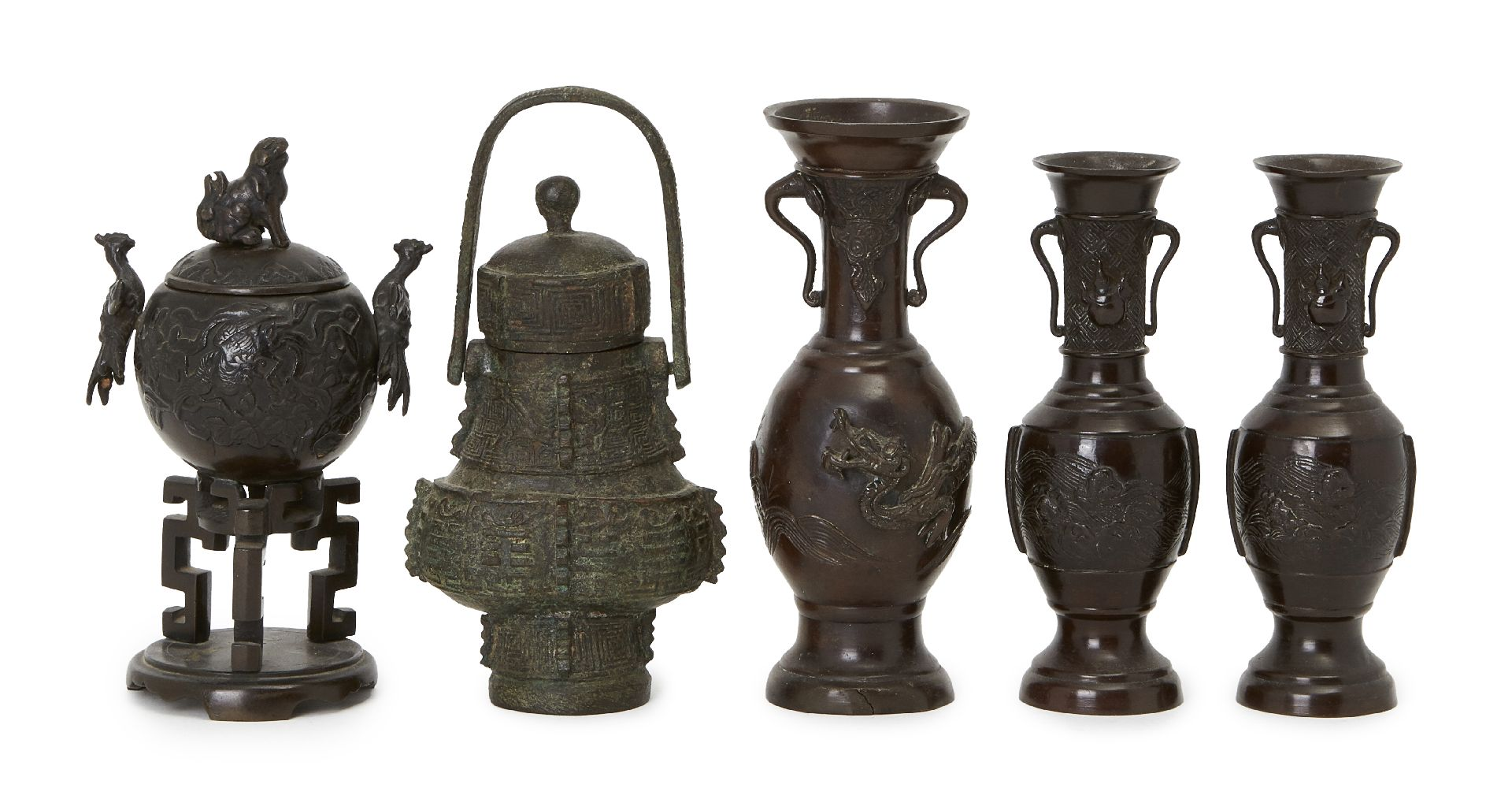 Group of five Japanese bronze vessels, Meiji period, to include a pair of baluster vases cast with