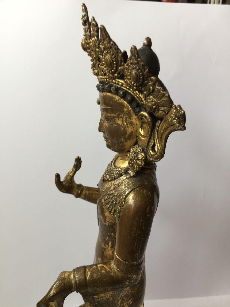A large Sino-Tibetan gilt bronze standing figure of Avalokiteshvara, 17th century, the right hand is - Image 5 of 16