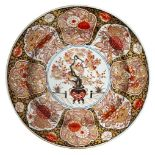 A fine and impressive Japanese porcelain large Imari charger, circa 1700, painted in the centre with