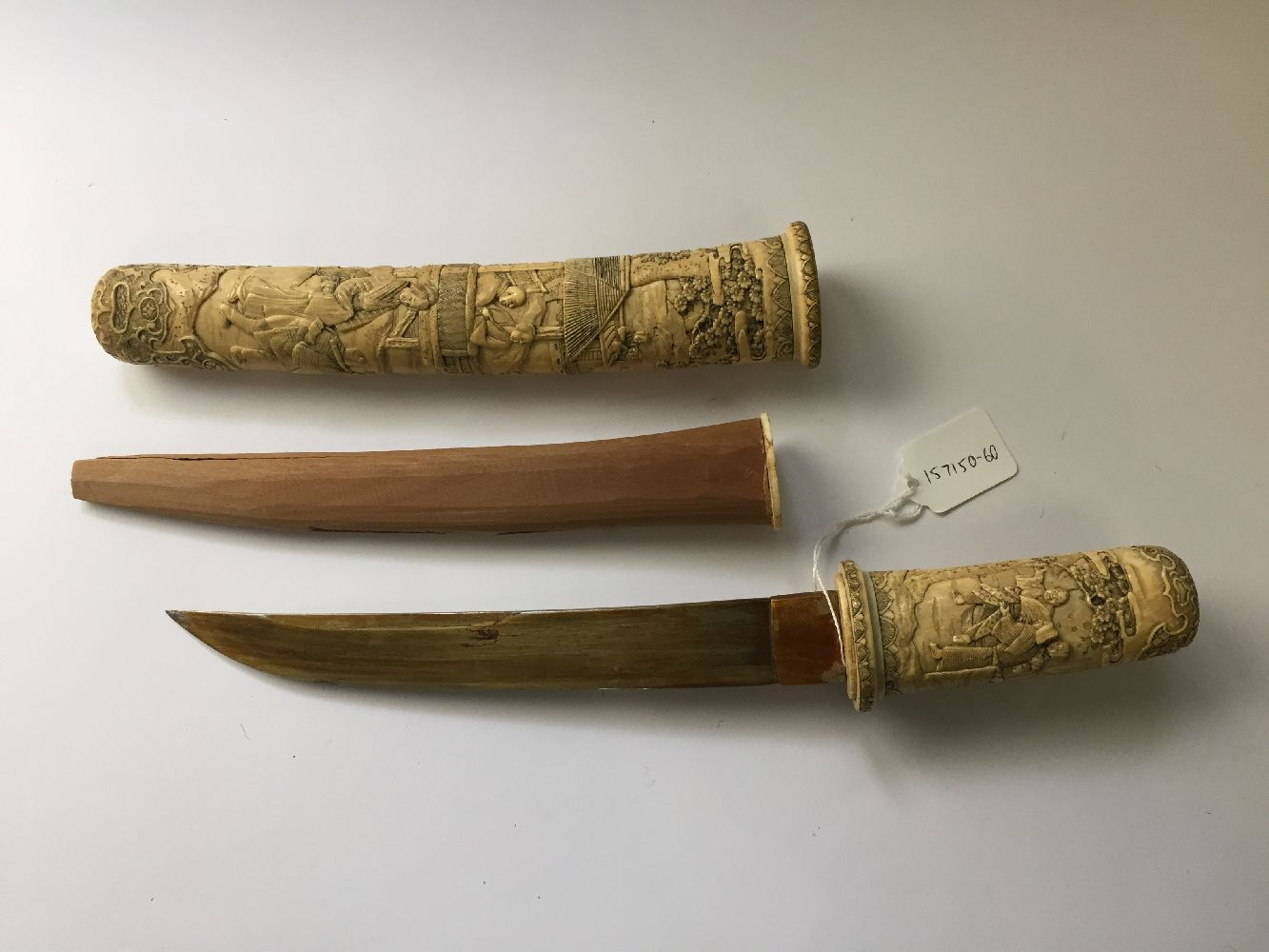 A Japanese carved ivory tanto, Meiji period, in slightly curved form, the scabbard and handle carved - Image 14 of 16