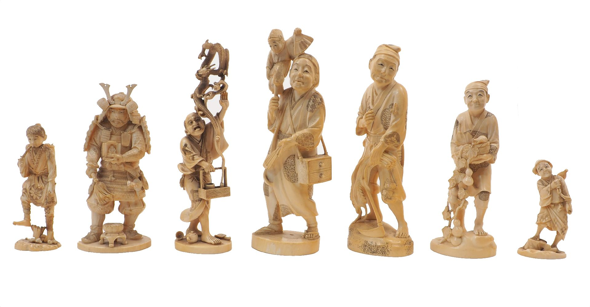A collection of seven Japanese Ivory okimono, Meiji Period, to include a farmer with scythe and crop