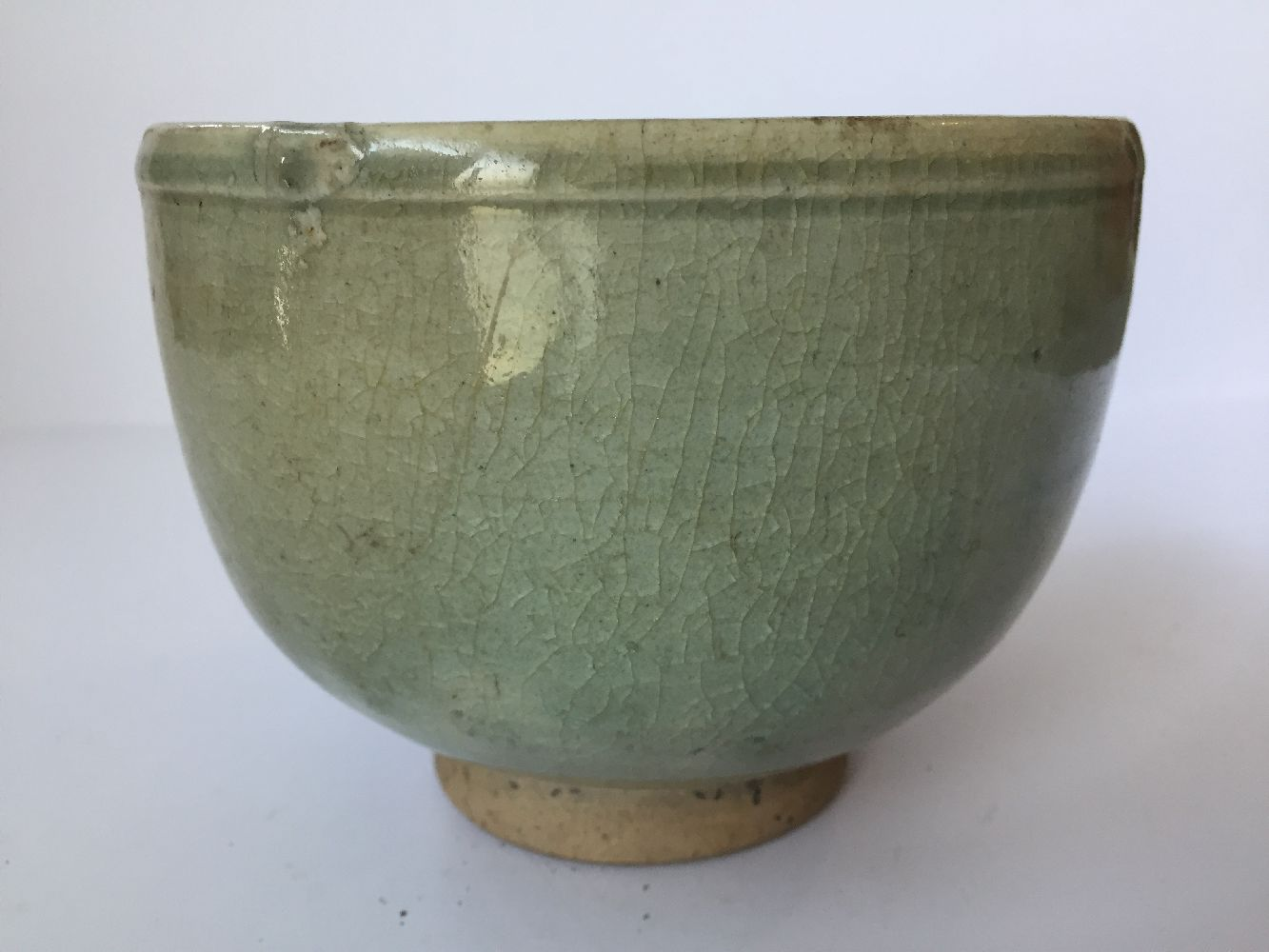 Three Thai Sawankhalok bowls, 15th-16th century, each covered in a celadon glaze, two with fluted - Image 20 of 27