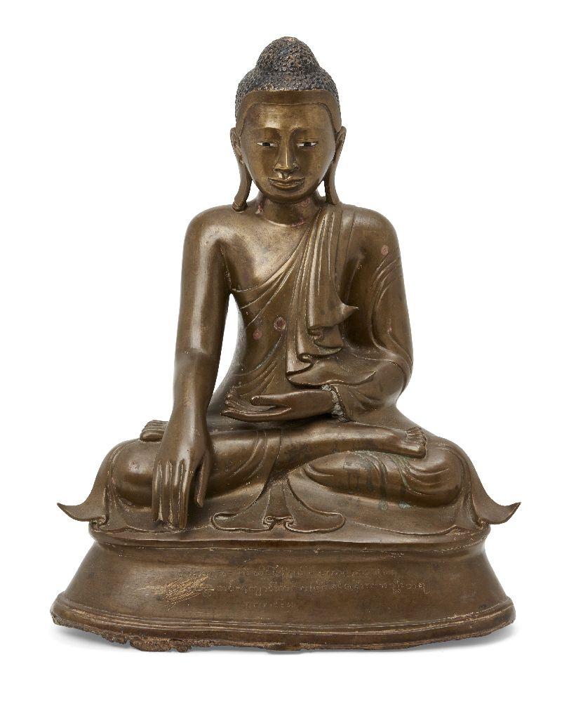 A Burmese bronze figure of Buddha, Mandalay period, 19th century, finely cast seated in vajrasana,