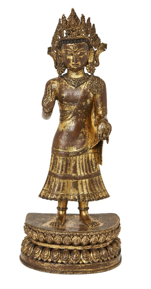 A large Sino-Tibetan gilt bronze standing figure of Avalokiteshvara, 17th century, the right hand is