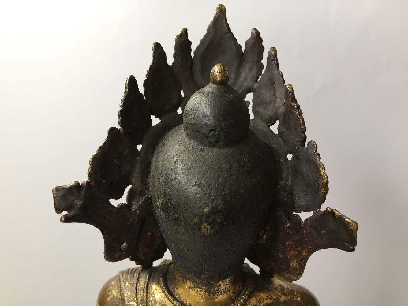 A large Sino-Tibetan gilt bronze standing figure of Avalokiteshvara, 17th century, the right hand is - Image 16 of 16