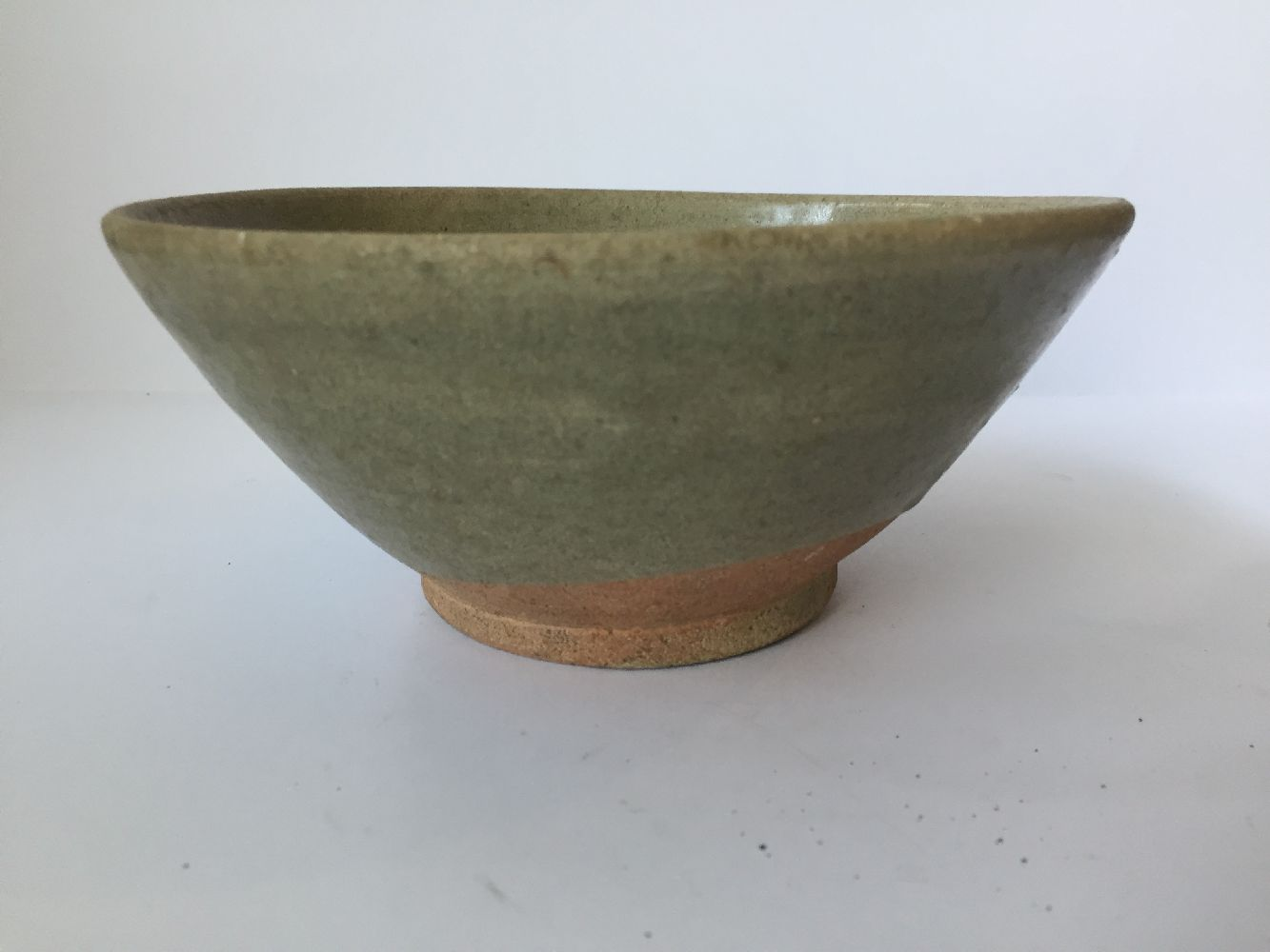 Three Thai Sawankhalok bowls, 15th-16th century, each covered in a celadon glaze, two with fluted - Image 5 of 27