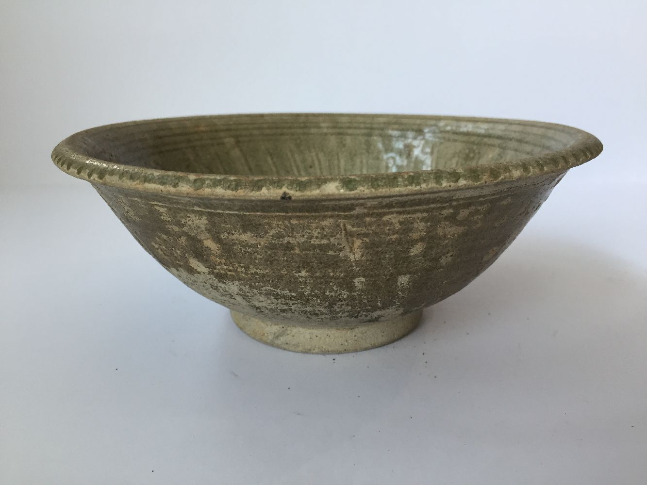 Three Thai Sawankhalok bowls, 15th-16th century, each covered in a celadon glaze, two with fluted - Image 26 of 27