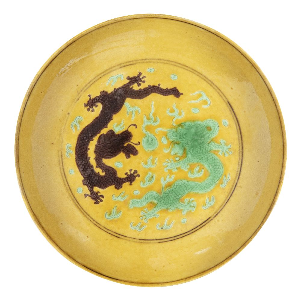 A Chinese imperial porcelain saucer dish, Tongzhi mark and of the period, painted in green and