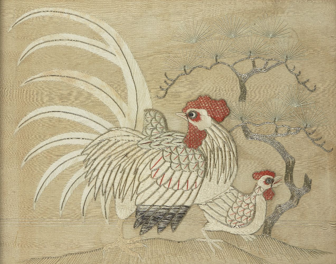 A Japanese silk embroidered rooster and hen, early 20th century, finely embroidered against pine, 55