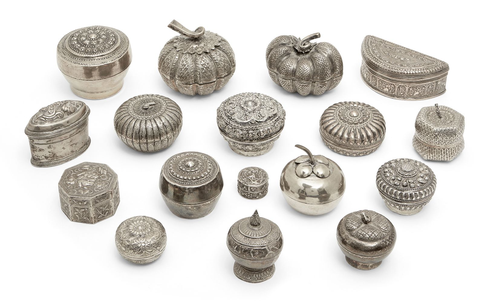 Seventeen Eastern white metal boxes, early 20th century, some modelled as fruit, some with