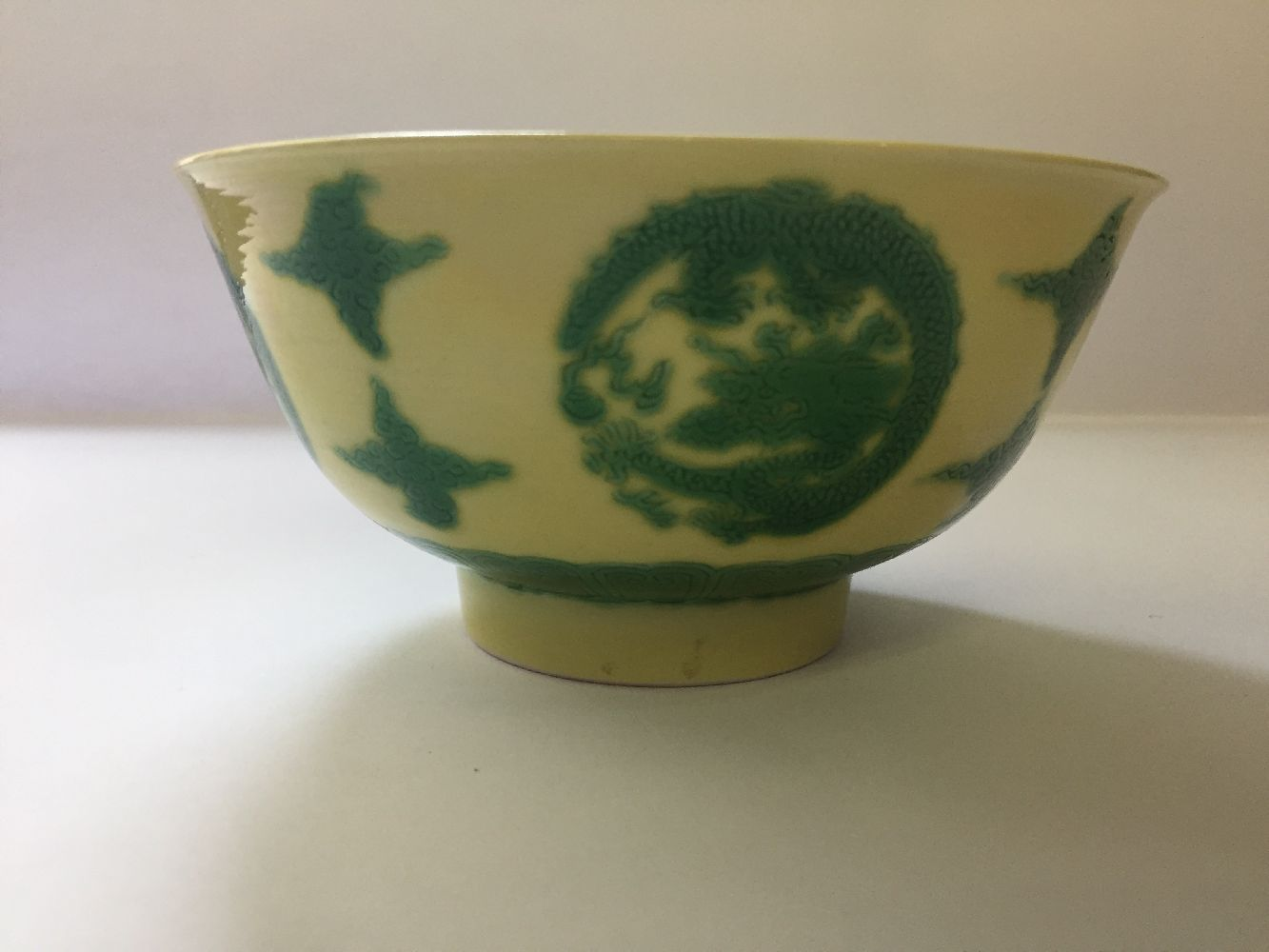 A Chinese porcelain yellow-ground green-enamelled 'dragon medallion' bowl, Kangxi mark and of the - Image 13 of 21