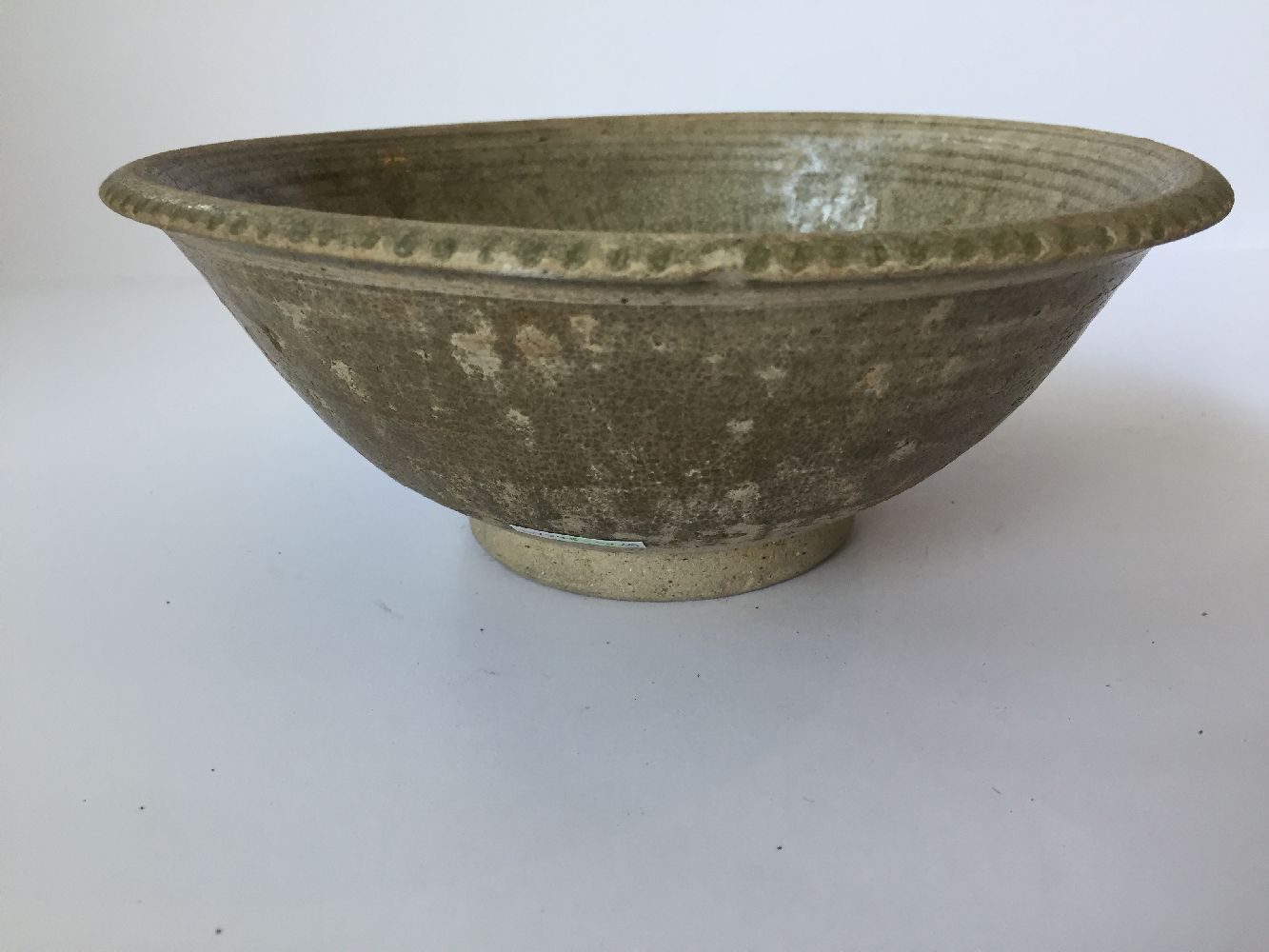 Three Thai Sawankhalok bowls, 15th-16th century, each covered in a celadon glaze, two with fluted - Image 2 of 27