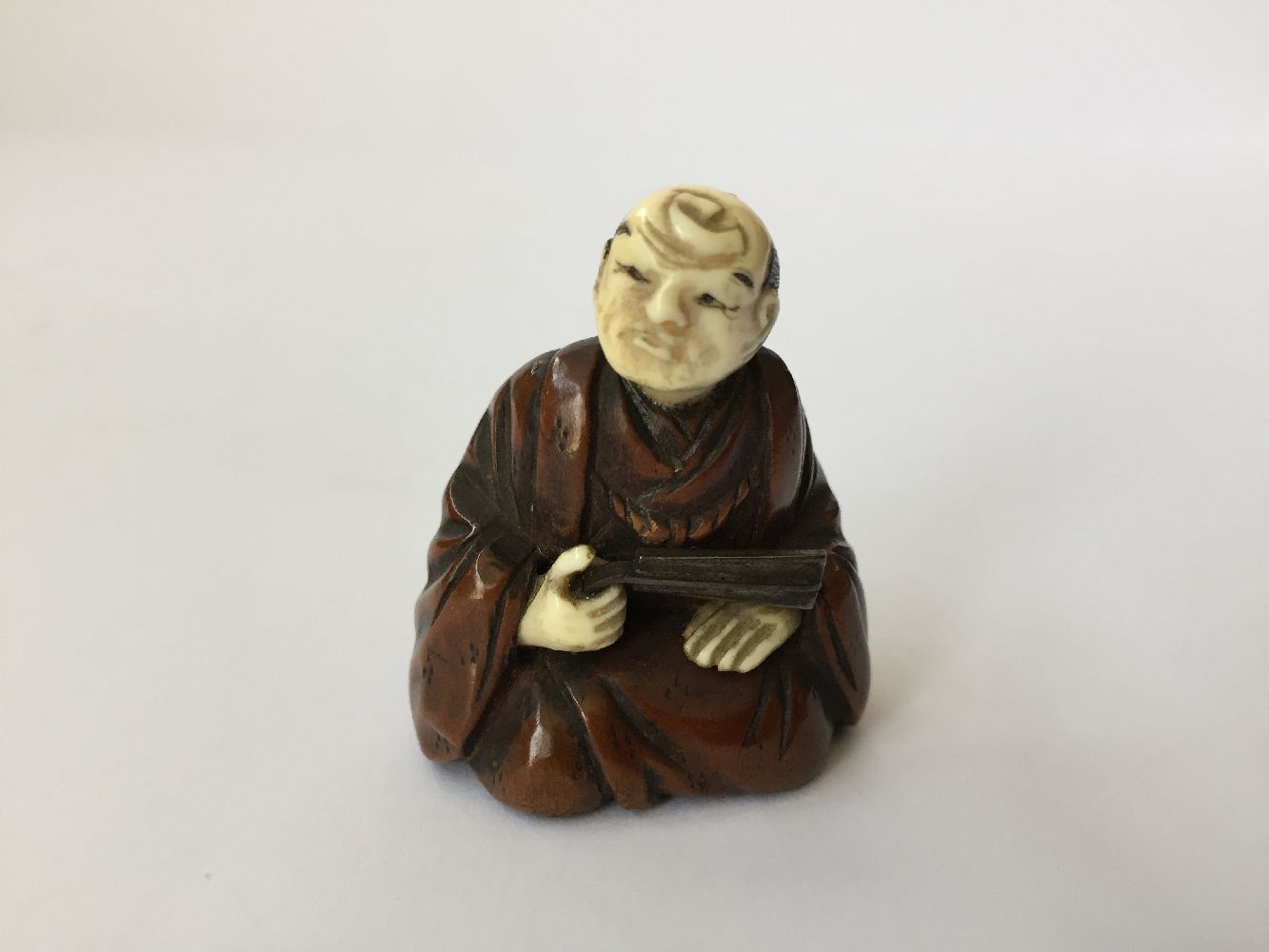 Three Japanese wood netsuke, 19th century, carved as Hotei and Karako playing Go; an Okina Noh mask; - Image 4 of 11