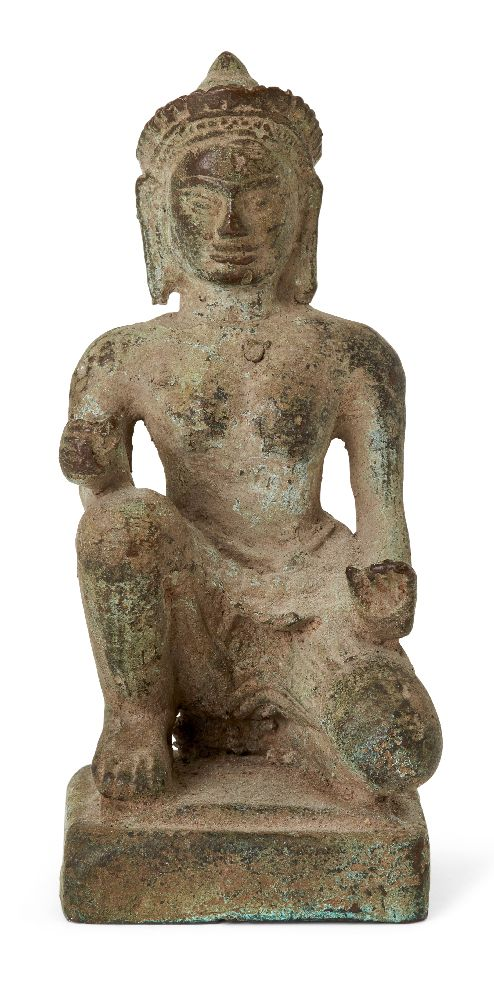 A Khmer bronze figure of Vishvakarman, 12th/13th century, seated in a half-kneeling position,