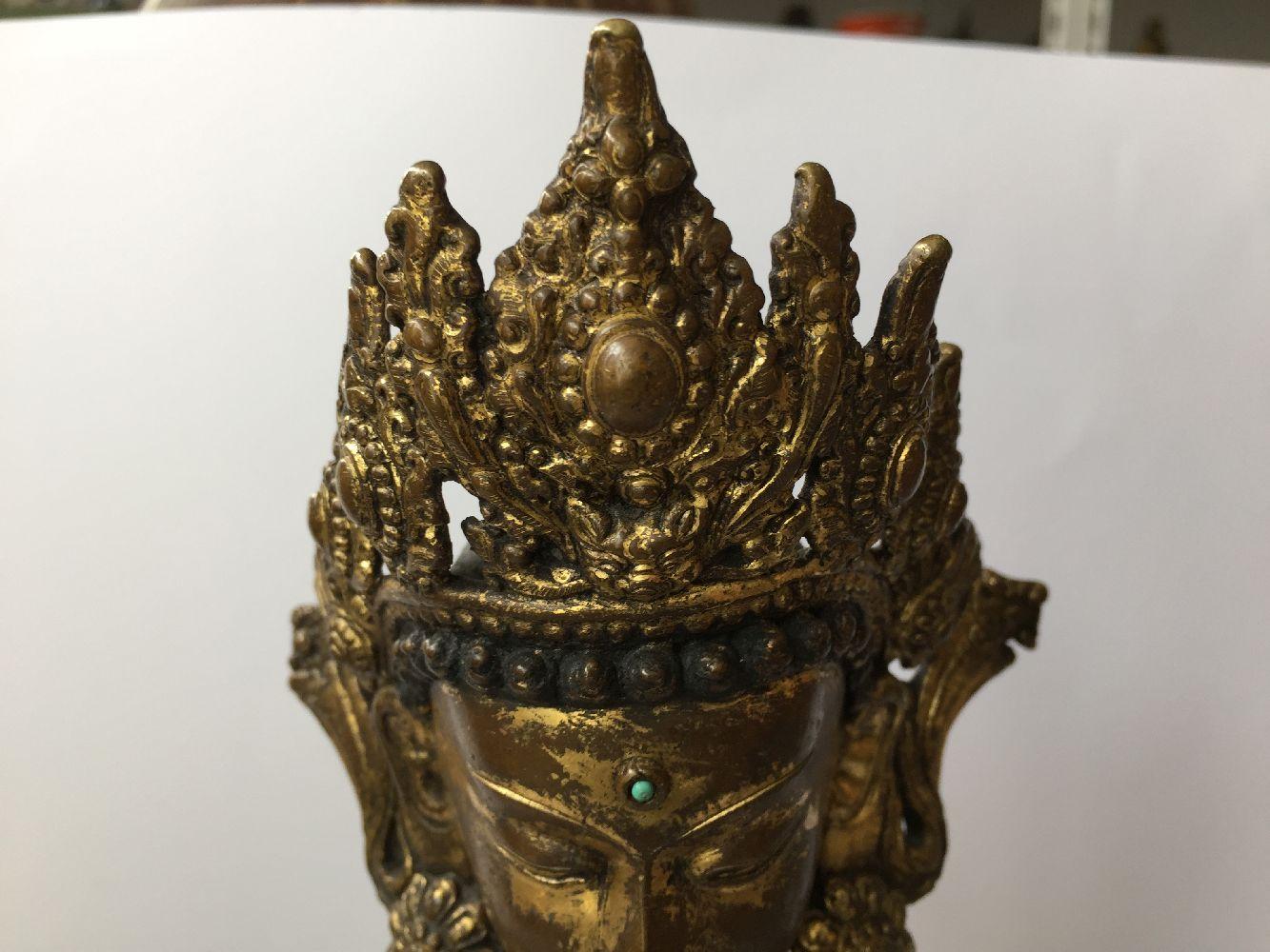 A large Sino-Tibetan gilt bronze standing figure of Avalokiteshvara, 17th century, the right hand is - Image 10 of 16