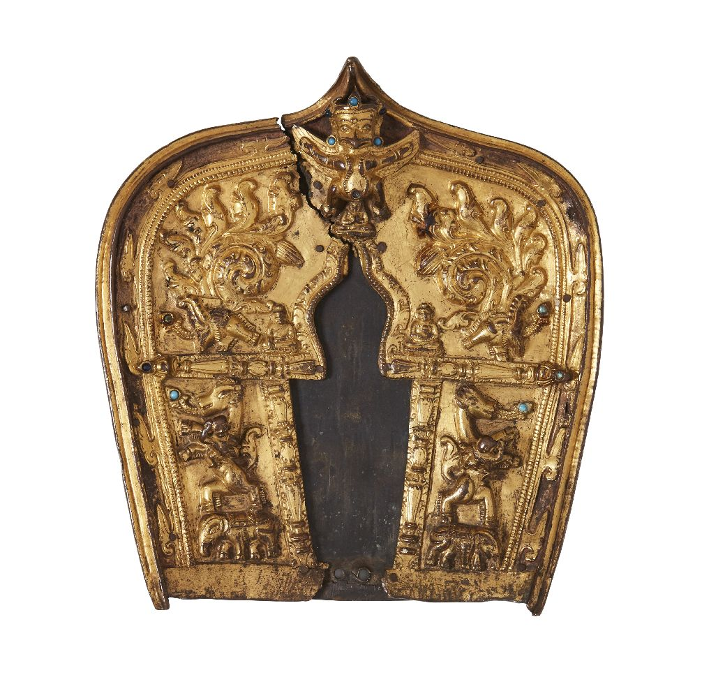 A Tibetan gilt bronze repousse plaque, 19th century, decorated to the centre with Garuda above