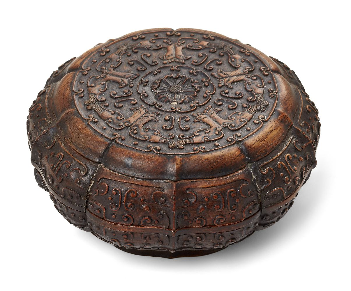 A Chinese carved suanzhi wood treasure box and cover, 18th/19th century, of decagonal lobed form