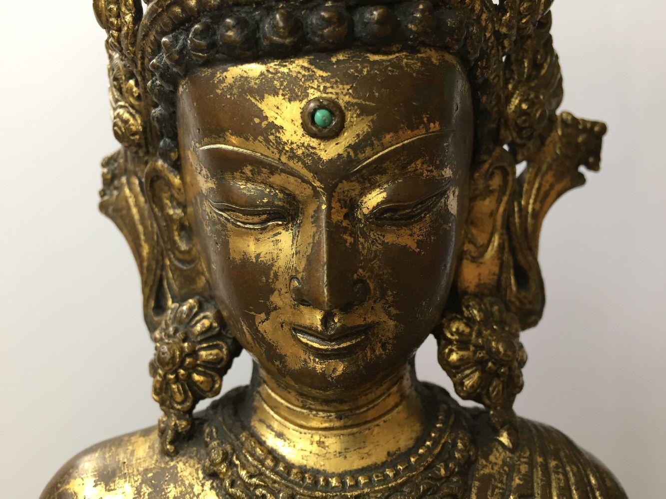 A large Sino-Tibetan gilt bronze standing figure of Avalokiteshvara, 17th century, the right hand is - Image 9 of 16