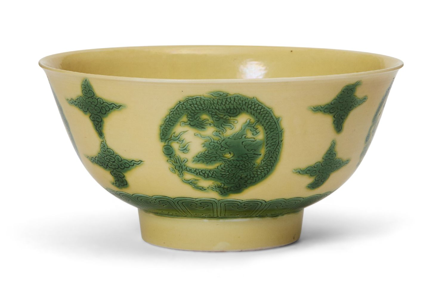 A Chinese porcelain yellow-ground green-enamelled 'dragon medallion' bowl, Kangxi mark and of the