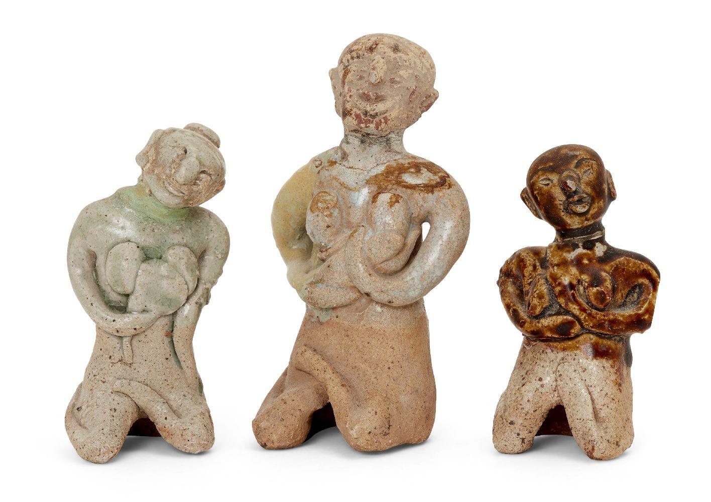 Three Thai Sawankhalok stoneware votive fertility figures, 14th-15th century, each modelled
