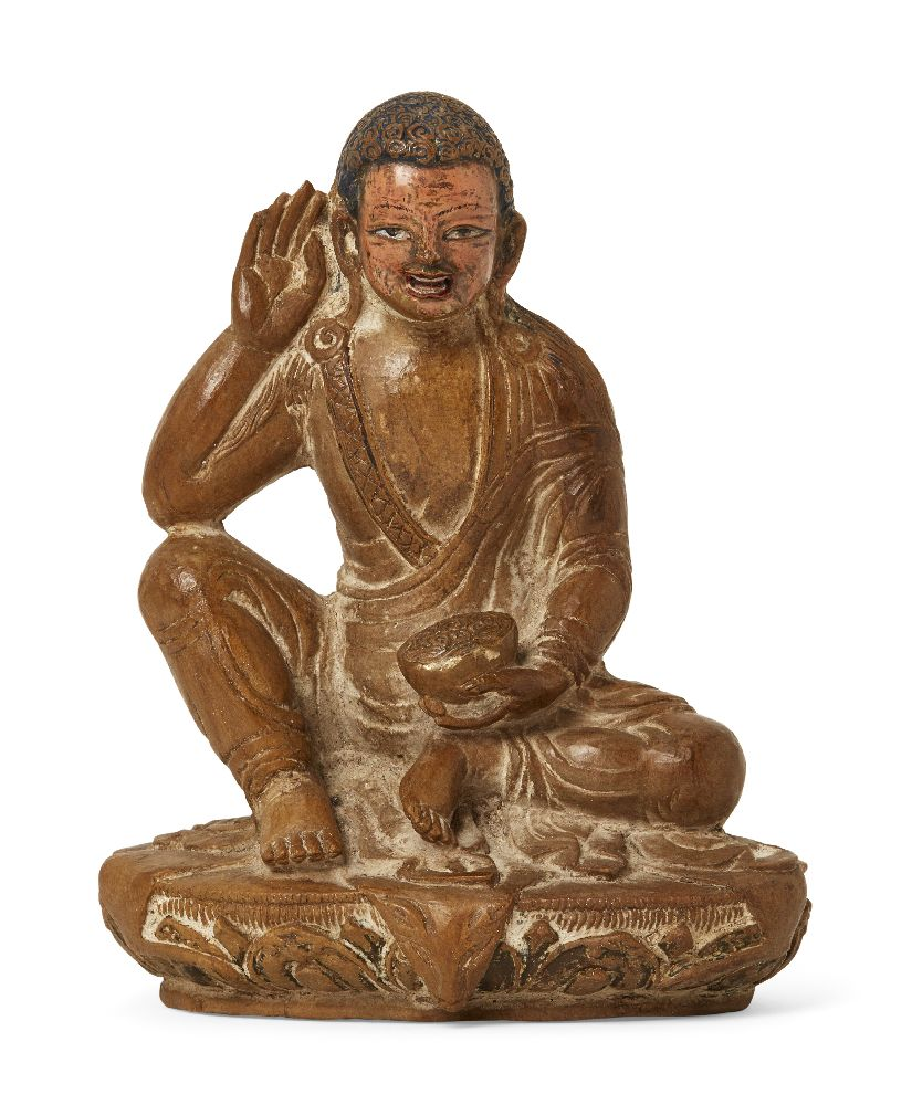 Property of a Gentleman (lots 36-85) A Tibetan carved hardstone figure of a monk, 18th/19th century,