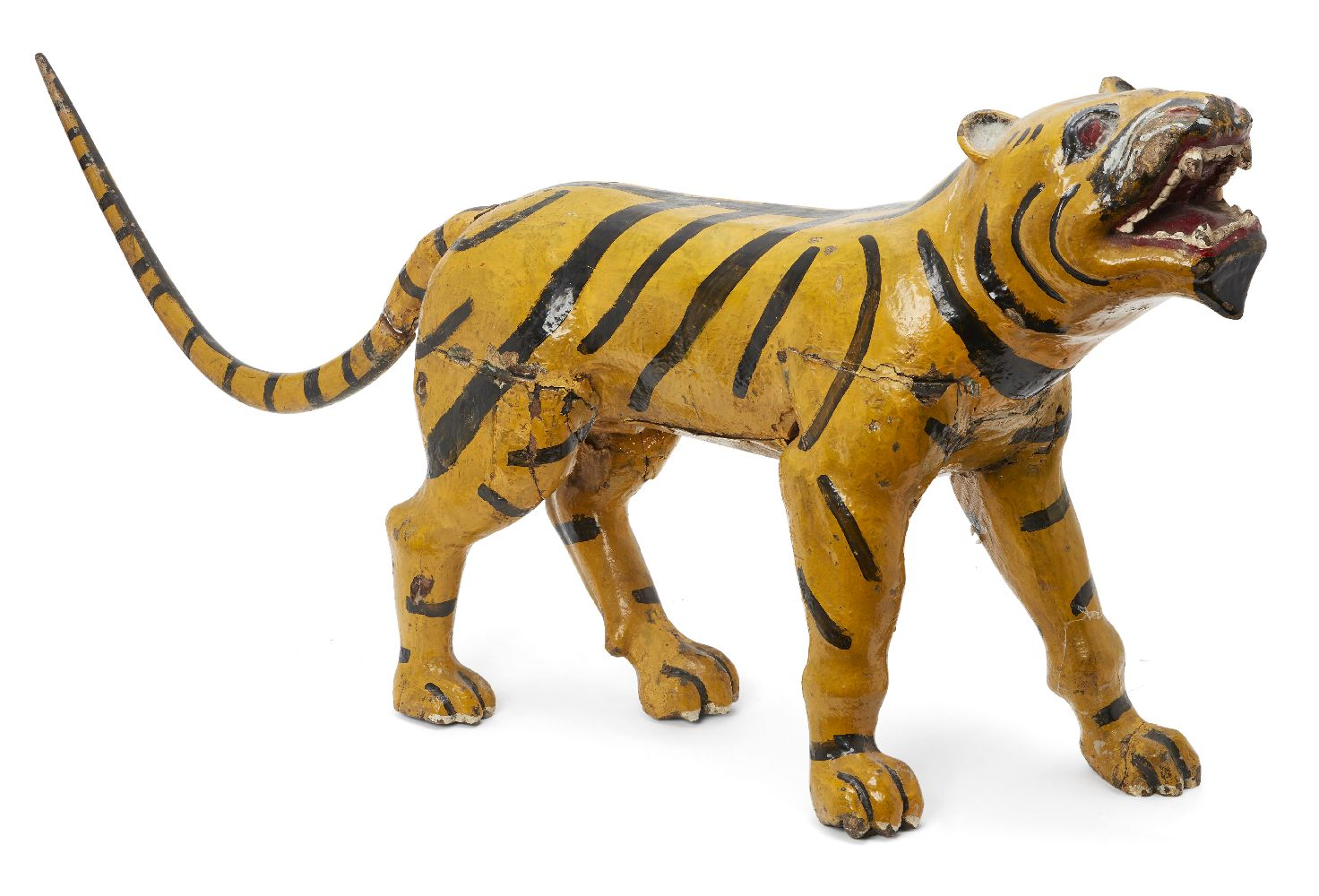 A Burmese painted wood tiger, Tai Yan (Shan States), early 20th century, prowling forwards in mid-